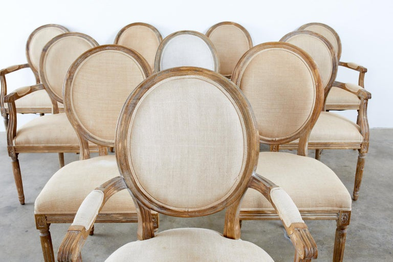 Hand-Crafted Set of Ten French Louis XVI Style Oak Dining Chairs For Sale
