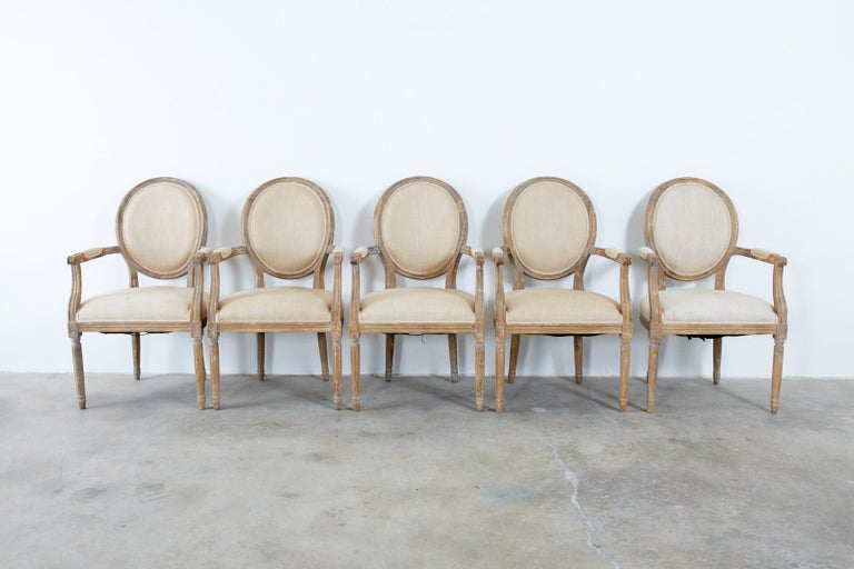Linen Set of Ten French Louis XVI Style Oak Dining Chairs For Sale