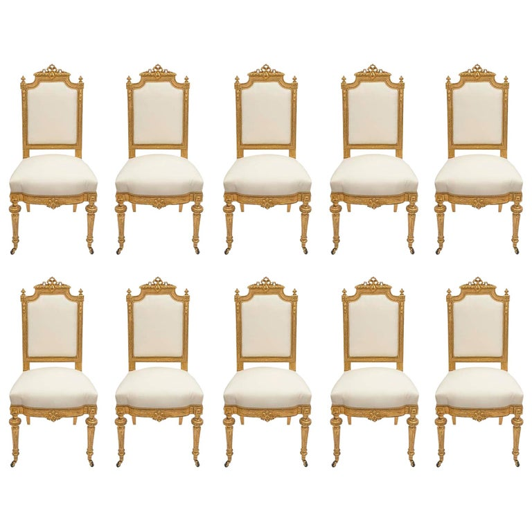 Set of Ten French Mid-19th Century Louis XVI Style Giltwood Dining Chairs For Sale