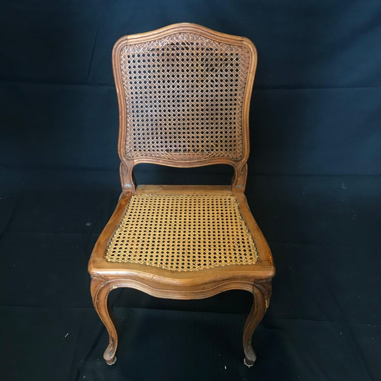 Set of Ten French Provincial Louis XV Style Walnut and Caned Dining Chairs In Good Condition For Sale In Hopewell, NJ
