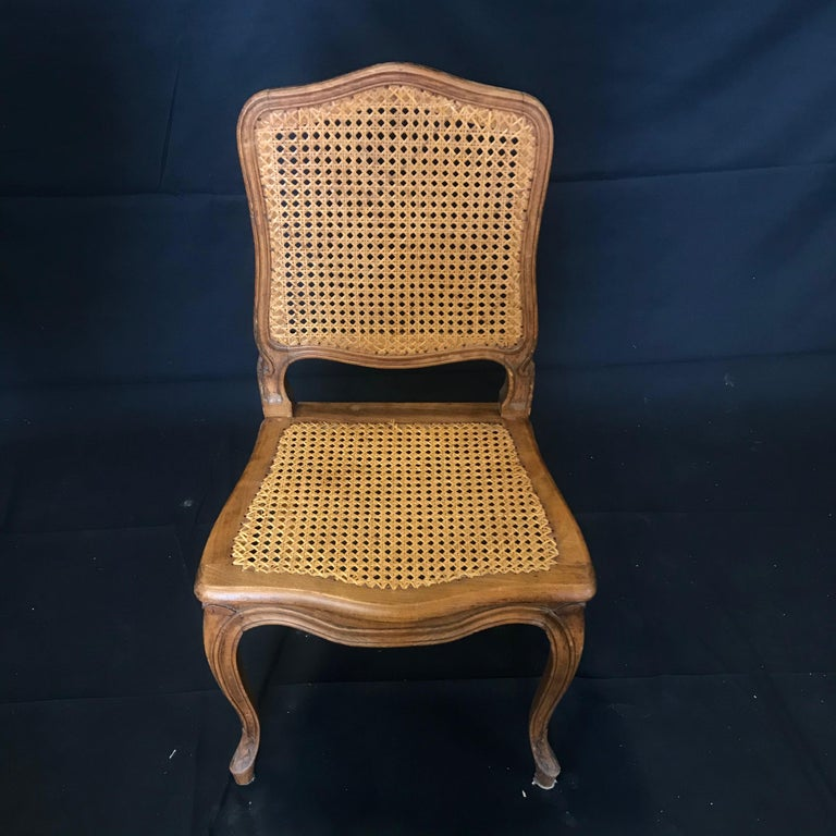 20th Century Set of Ten French Provincial Louis XV Style Walnut and Caned Dining Chairs For Sale