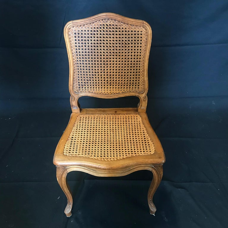 Set of Ten French Provincial Louis XV Style Walnut and Caned Dining Chairs For Sale 1