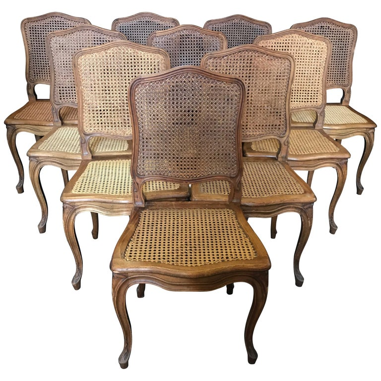 Set of Ten French Provincial Louis XV Style Walnut and Caned Dining Chairs For Sale