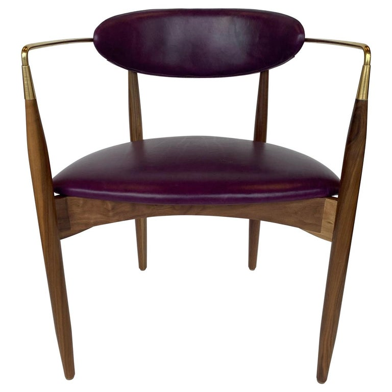 Set of ten Italian chairs made in walnut wood and polished brass detail. Made in Italy, circa 1980s.  Newly upholstered and newly refinished.