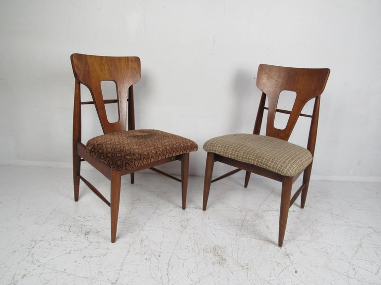 A unique set of ten vintage modern dining chairs designed in the style of,