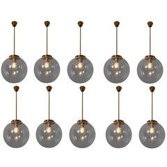 Set of Ten Midcentury Pendants in Handblown Glass and Copper Color Fixture