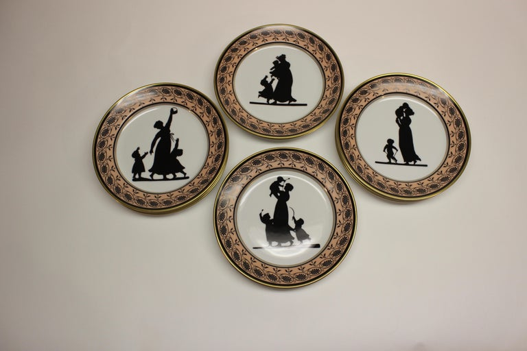 Vintage Mottahedeh Vista Alegre silhouette dessert plates with a decorative pink and black border. The plates are Motthahedeh copies of an early 19th century Coalport design featuring members of the Angerstein family in silhouette circa 1805-1810.