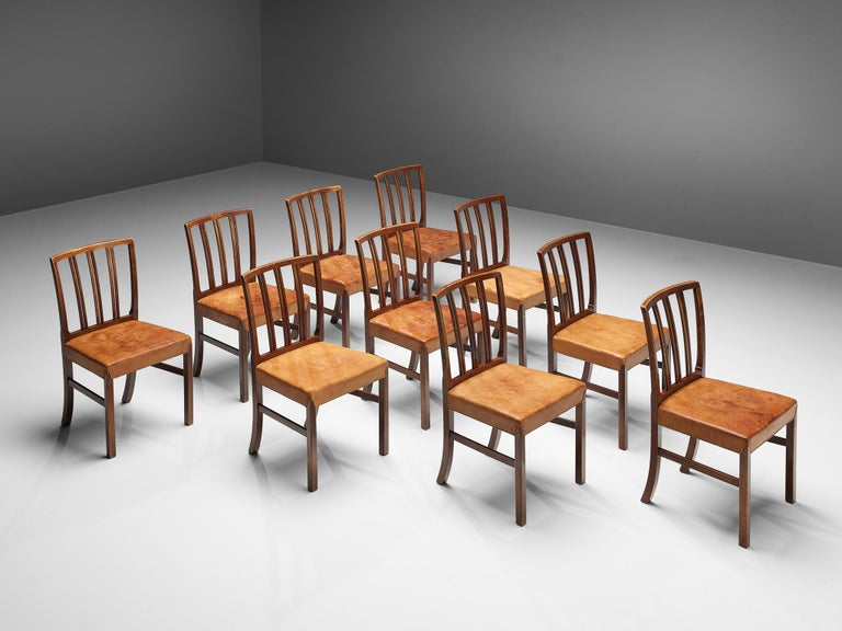 Ole Wanscher for Fritz Hansen, set of 10 dining chairs, walnut, cognac leather, Denmark, 1960s  Excellent set of dining chairs designed by Ole Wanscher for Fritz Hansen. The elegant model has a very notable backrest with a slight curve, flowing
