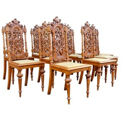 Set of Ten Spanish Revival Dining Chairs in Oak Circa 1920