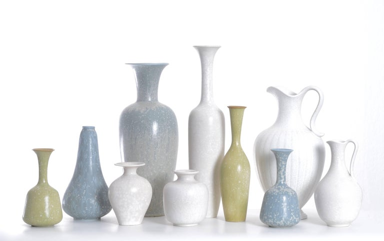 Set of ten stoneware vases in beautiful pastel colors by Gunnar Nylund for Rörstrand, Sweden. Measure: Height 11-36cm.