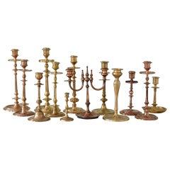 Set of thirteen Scandinavian Art Deco Solid Bass & Copper Candleholders