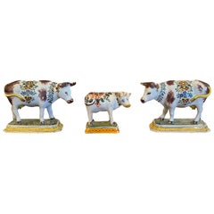 Set of Three 19th Century Dutch Delft Polychrome Porcelain Cows, One Marked