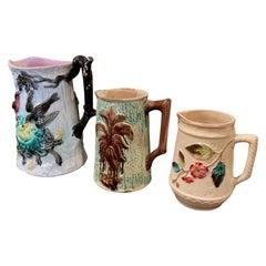 Set of Three 19th Century French Barbotine Ceramic Pitchers