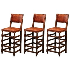 Set of Three 19th Century French Carved Oak and Brown Leather Bar Stools