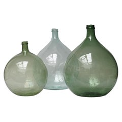 Set of Three 19th Century Large Blown Dame Jeanne, Bonbonne Green Glass Bottles