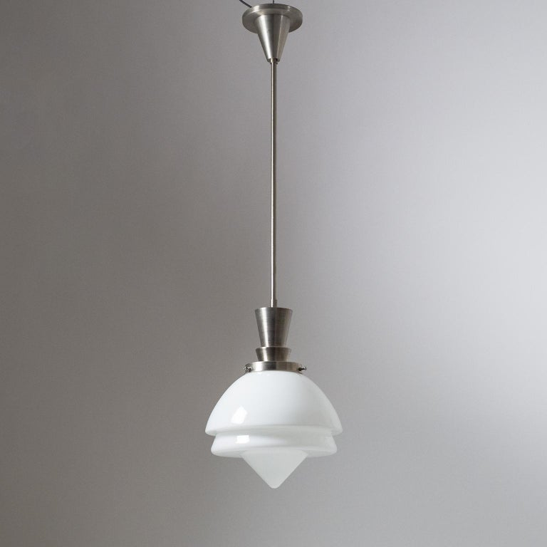 Excellent Art Deco pendants with brushed nickeled brass hardware and triple layer blown glass. These are of very high build quality with just a light patina on the metal parts. One E27 socket with new wiring. Height without the stem is