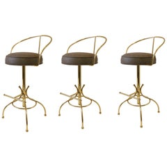 Set of Three Brass and Suede Leather Swivel Barstools by Charles Hollis Jones