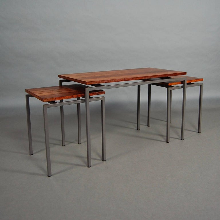 Gorgeous and rare set of three nesting tables in Brazilian rosewood.  Designer: Attributed Pastoe  Manufacturer: Attributed Cees Braakman  Country: Netherlands  Model: Nesting tables  Designed in: 1950s-1960s  Date of manufacturing: