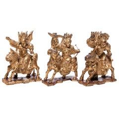 Set of Three Chinese Mythical Gilt Figures, circa 1850