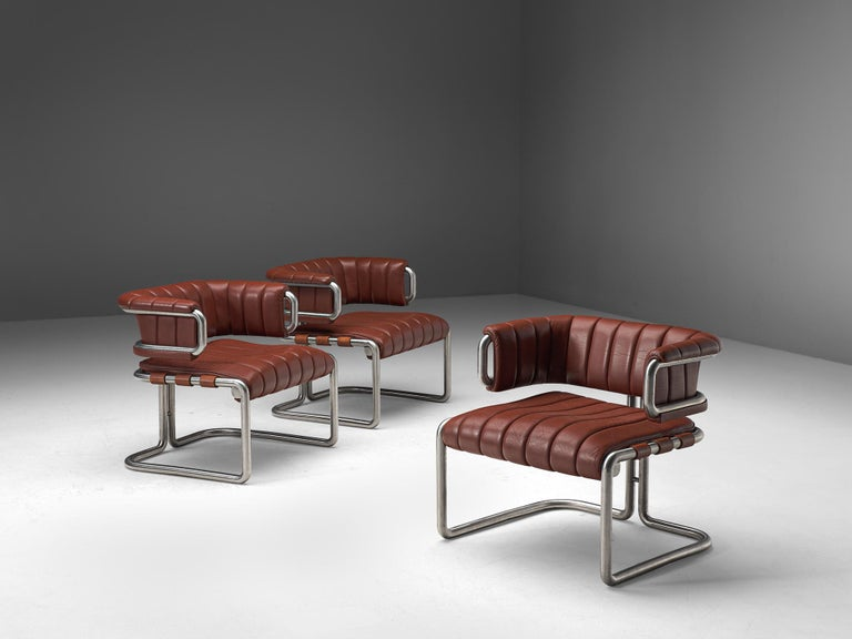 Set of three lounge chairs, leather and metal, Germany, 1960s