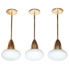 Set of 3 Custom Modernist Brass and Frosted Glass Pendants by High Style Deco