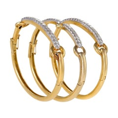 Set of Three David Webb Gold, Platinum and Diamond Bangles