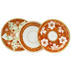 Set of Three Early 19th Century English Coral and Gold Porcelain Plates