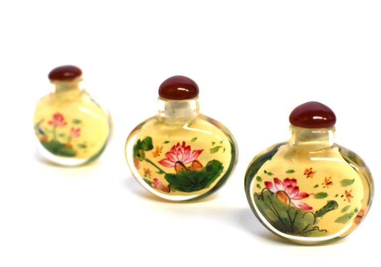 Chinese Set of Three Eglomise Reverse Painted Snuff Bottles with Lotus For Sale