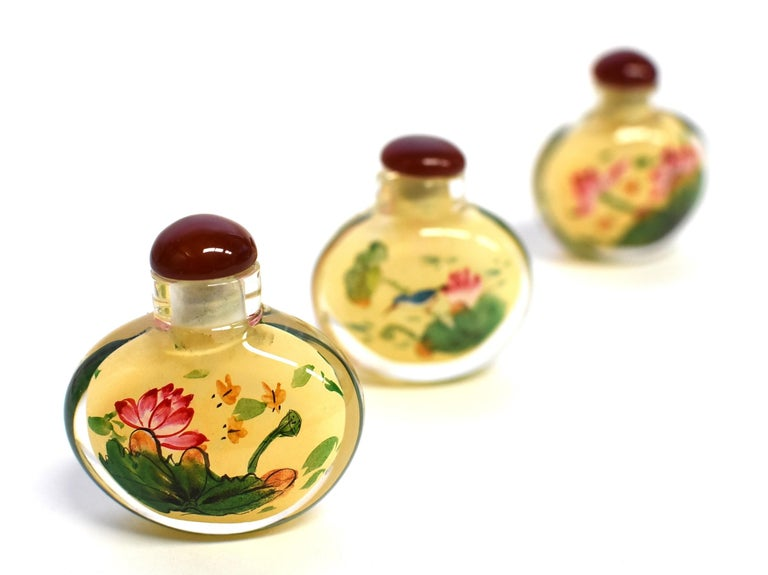 Agate Set of Three Eglomise Reverse Painted Snuff Bottles with Lotus For Sale