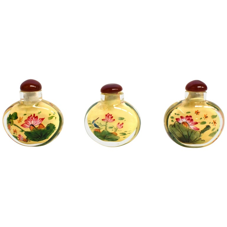 Set of Three Eglomise Reverse Painted Snuff Bottles with Lotus For Sale