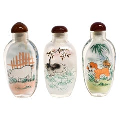 Set of Three Eglomise Reverse Painted Snuff Bottles with Zodiac Animals