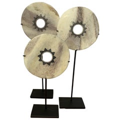 Set of Three Engraved White Bone Discs on Stands, Indonesia, Contemporary