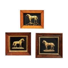 Set of Three Framed Gilt Bronze Horses Mounted on Black Velvet, circa 1850