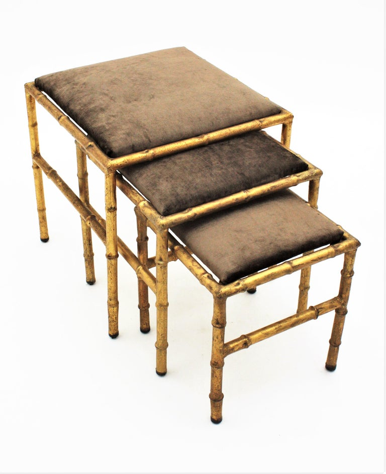 French Set of Three Gilt Iron Faux Bamboo Nesting Stools Upholstered in Taupe Velvet For Sale