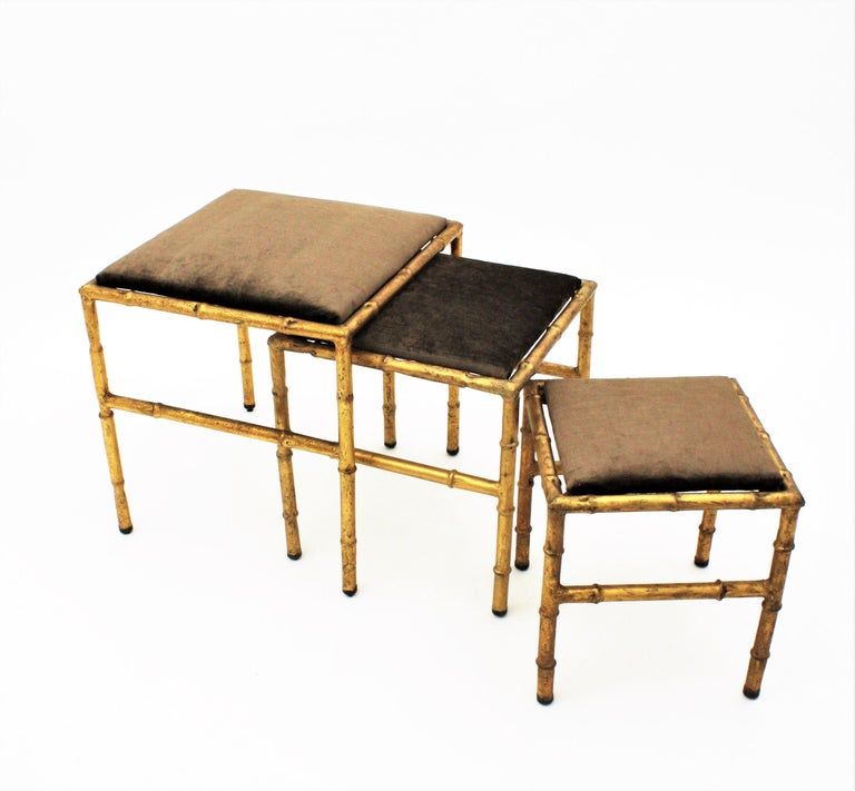 Set of Three Gilt Iron Faux Bamboo Nesting Stools Upholstered in Taupe Velvet In Excellent Condition For Sale In Barcelona, ES