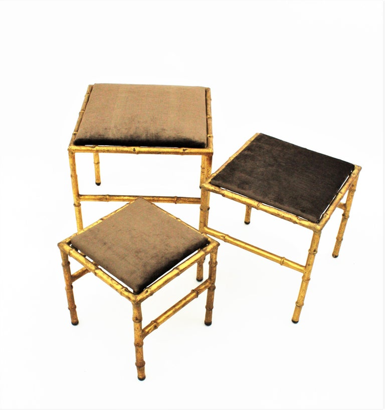 20th Century Set of Three Gilt Iron Faux Bamboo Nesting Stools Upholstered in Taupe Velvet For Sale