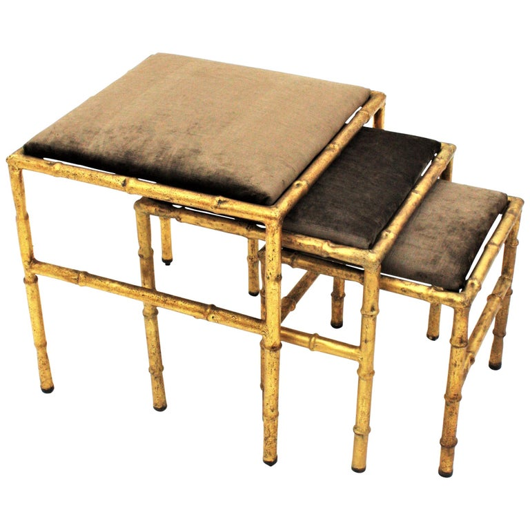Set of Three Gilt Iron Faux Bamboo Nesting Stools Upholstered in Taupe Velvet For Sale