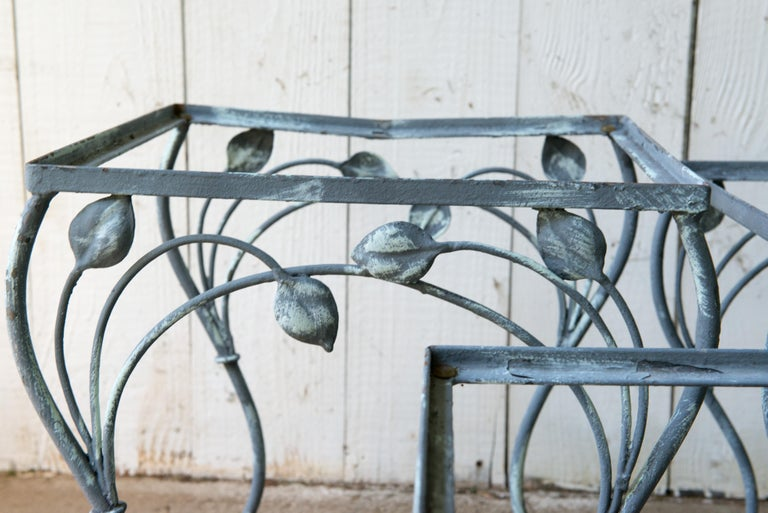 Set of 3 handcrafted wrought iron nesting tables by Salterini. Beautiful, elegant yet strong sturdy pieces. Glass table tops will be included. We have several other pieces of matching Salterini seating pieces.