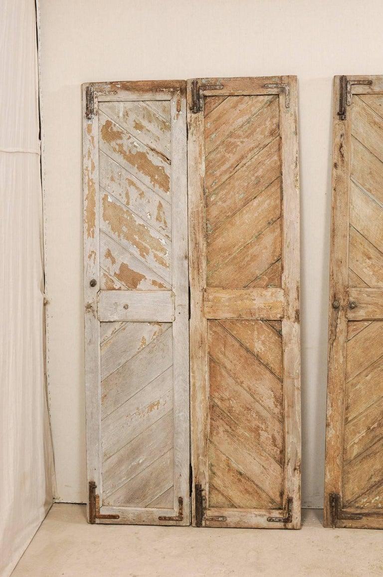 Set of Three Hinged-Pairs of Carved Wood European Rustic Doors In Good Condition For Sale In Atlanta, GA