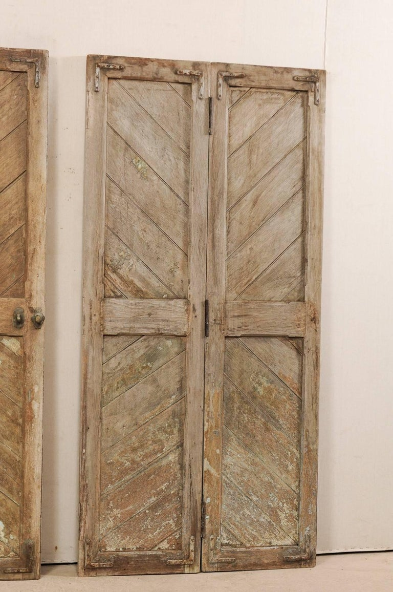 20th Century Set of Three Hinged-Pairs of Carved Wood European Rustic Doors For Sale