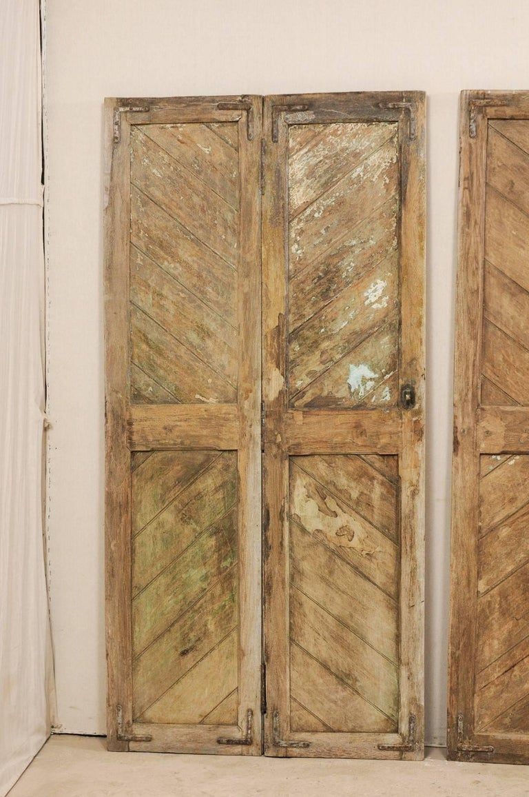 Set of Three Hinged-Pairs of Carved Wood European Rustic Doors For Sale 2
