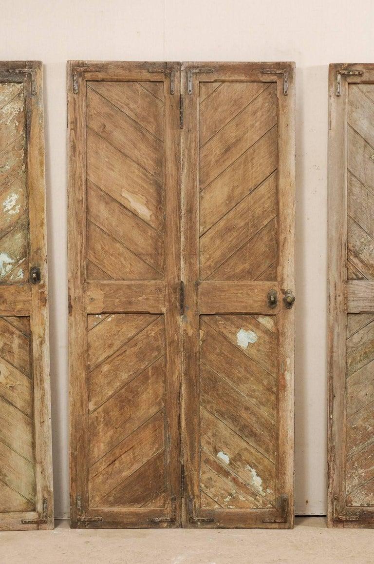 Set of Three Hinged-Pairs of Carved Wood European Rustic Doors For Sale 3