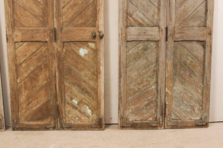 Set of Three Hinged-Pairs of Carved Wood European Rustic Doors For Sale 4
