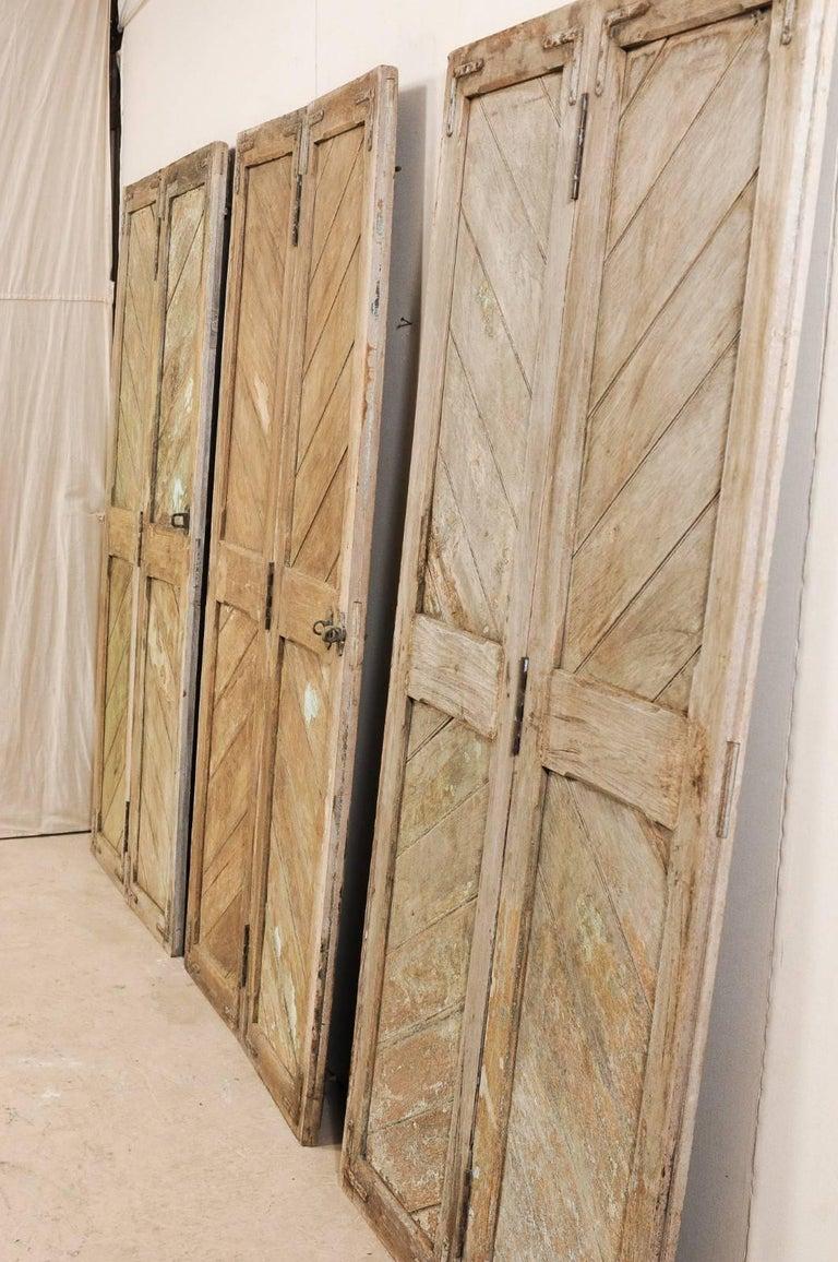 Set of Three Hinged-Pairs of Carved Wood European Rustic Doors For Sale 5