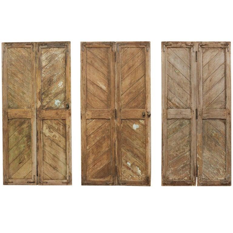 Set of Three Hinged-Pairs of Carved Wood European Rustic Doors For Sale