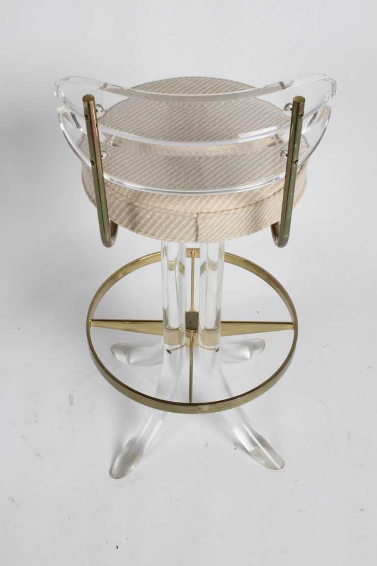 Late 20th Century Set of Three Hollywood Regency Lucite with Brass Swivel Bar Stools by Hill MFG For Sale
