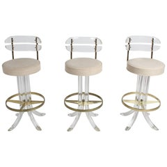 Set of Three Hollywood Regency Lucite with Brass Swivel Bar Stools by Hill MFG