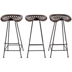 Set of Three Industrial Modern Tractor Seat Swivel Stools, 1950s