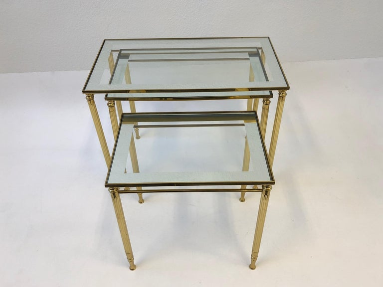 Hollywood Regency Set of Three Italian Brass and Glass Nesting Tables by Maison Baguès For Sale