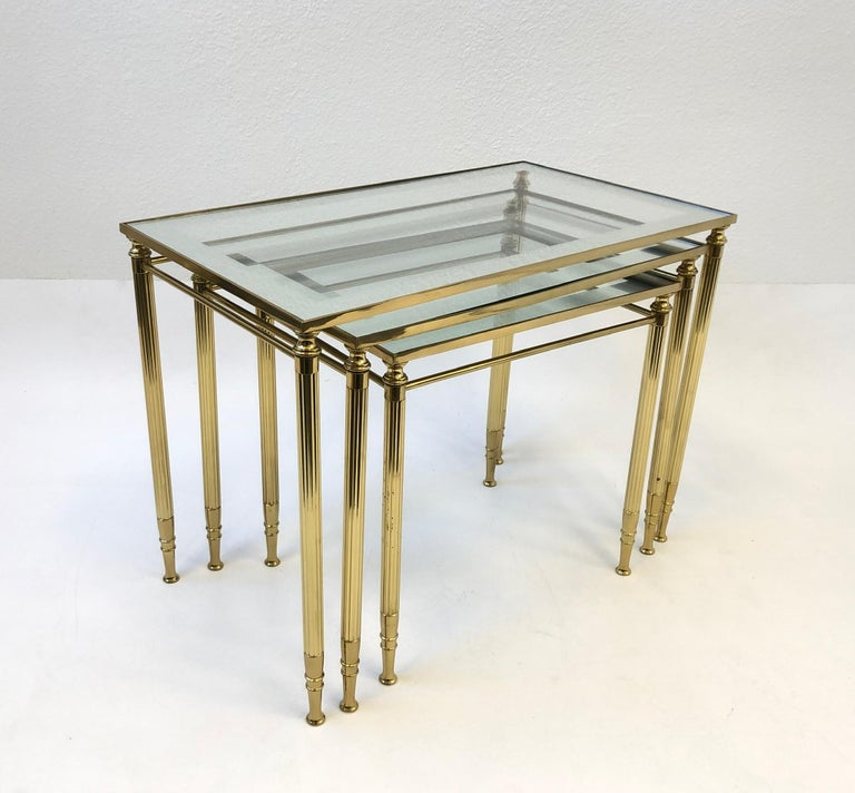 Late 20th Century Set of Three Italian Brass and Glass Nesting Tables by Maison Baguès For Sale
